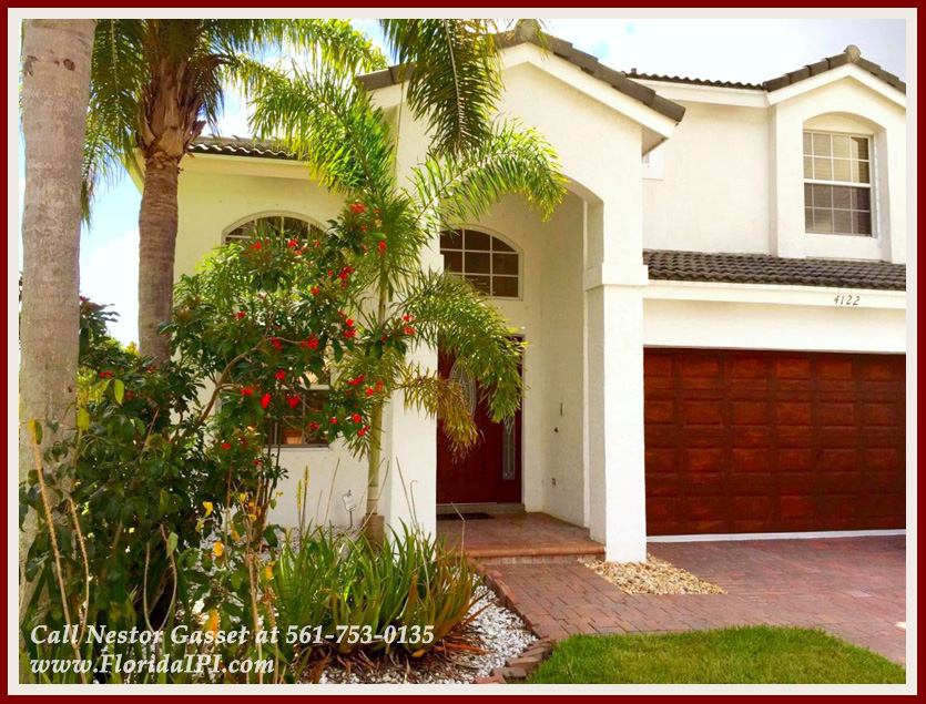 The Isles at Wellington Lakefront Home For Rent - 4122 Bluff Harbor Way Wellington FL 33449 - Exterior Front
