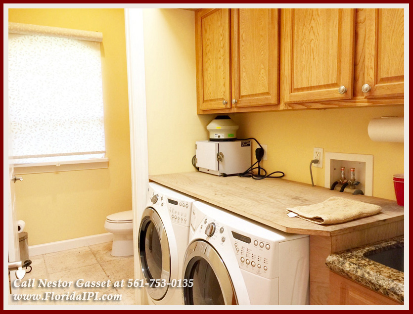 Equestrian Homes For Sale in Fox Trail Loxahatchee FL - 1154 -1092 Clydesdale Drive Loxahatchee FL 33470 - Laundry Room and Half Bathroom