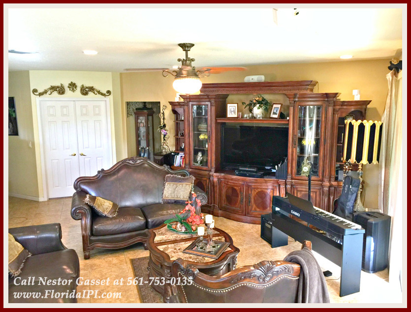 Olympia Wellington FL Home For Sale - The spacious family room of this Wellington FL home for sale in Olympia is perfect for a large entertainment center!