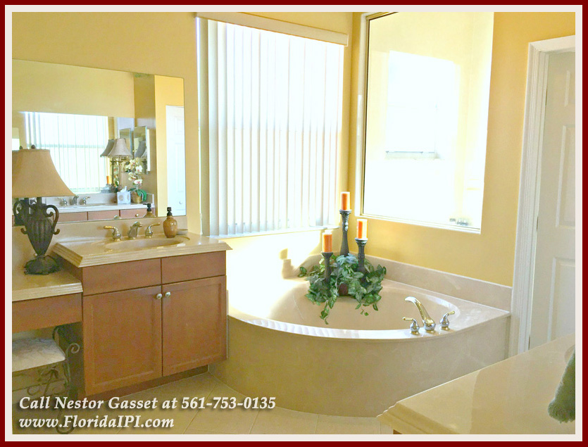 Olympia Wellington FL Home For Sale - Relax in your Roman tub and enjoy a warm bubble bath at the master bathroom of this Wellington Fl home for sale in Olympia!