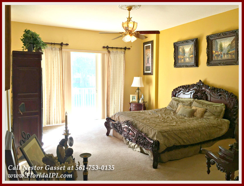 Wellington FL Home For Sale Olympia - The master bedroom of this Olympia home for sale in Wellington FL has a walk-in closet and a balcony perfect for viewing your garden.