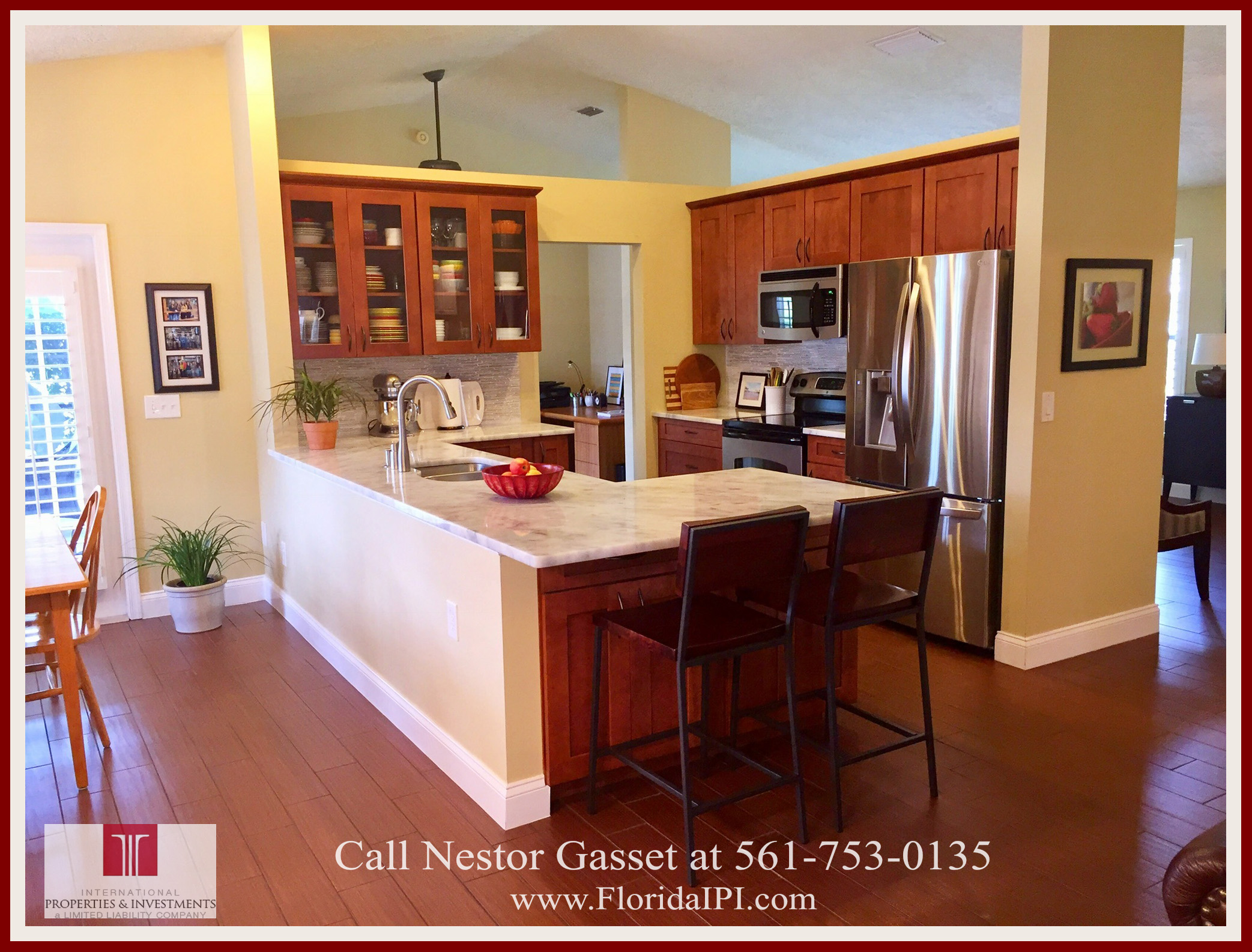 Homes For Sale Near Binks Elementary School in Wellington FL - The newly renovated kitchen has a relaxing view overlooking the swimming pool.
