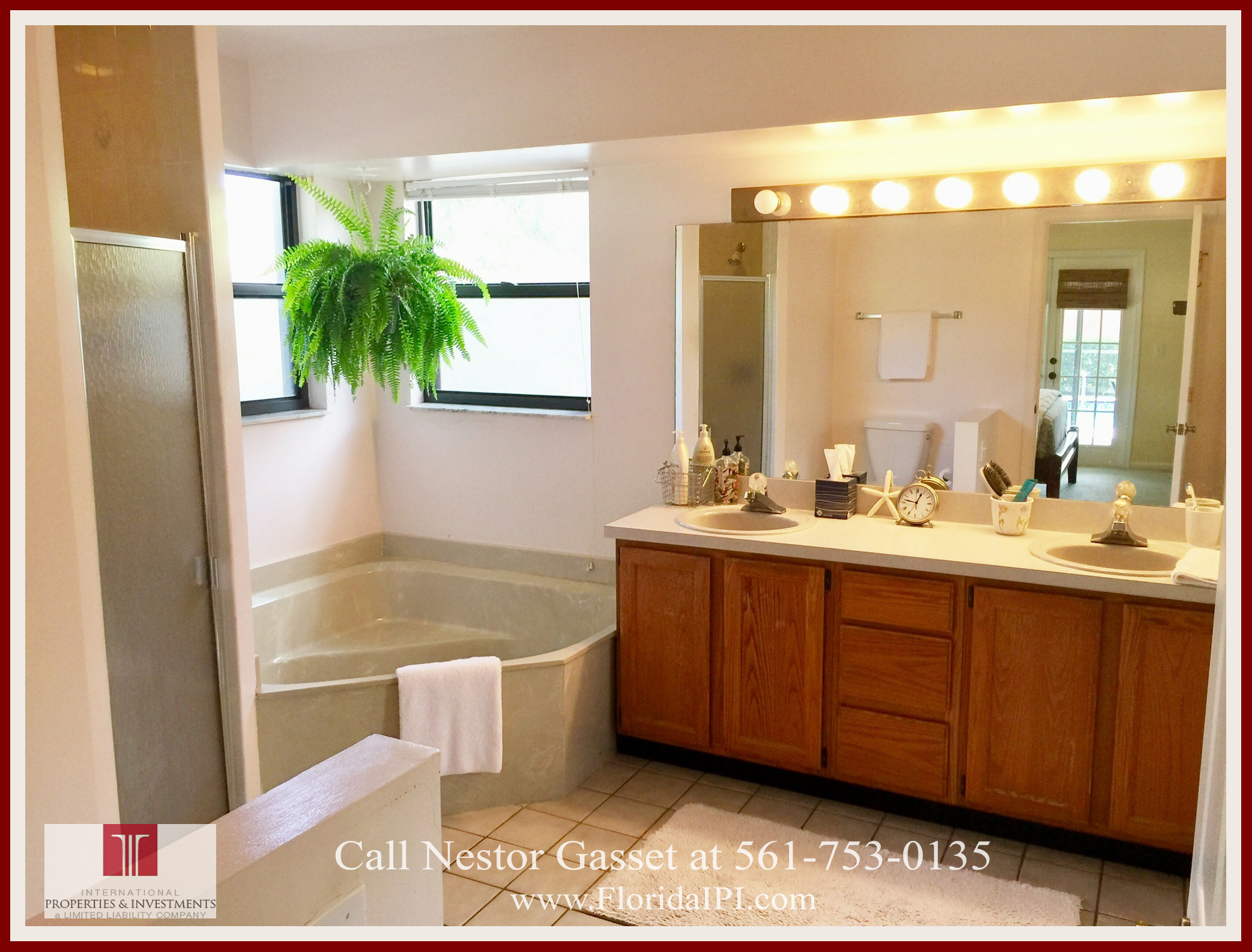 Wellington FL Sugar Pond Manor Home For Sale - The master bathroom of the home features a bath tub, separate shower, and a vanity counter top with his and her sinks.