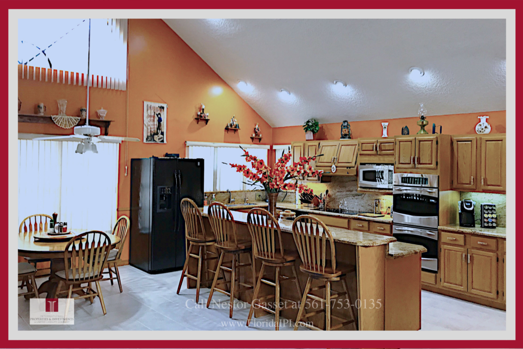 Loxahatchee Equestrian Properties for Sale  -  The light-filled kitchen of this Loxahatchee FL equestrian property for  sale is ready for your inner chef anytime!