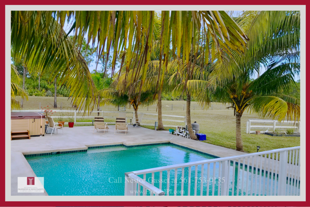 Loxahatchee FL Equestrian Ranch for Sale - Relax and enjoy in the  beautiful saltwater pool of this Loxahatchee FL equestrian ranch for sale.